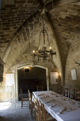 Ancien prieuré Saint-Michel de Grandmont - English:  At the other end of the room for pilgrims, a door gave access to the corridor serving the church and the passage of the deads. The current door of indeterminate origin is a reuse for expansion.
