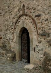 Eglise Saint-Saturnin - Español: La Iglesia de Saint-Saturnin de Boule-d'Amont, es un templo románico construida en el siglo XI. Está ubicada en el centro de Boule-d'Amont, Francia. Detalle de la puerta.