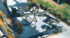 Manufacture d'armes, actuellement Musée de l'automobile - English: Soviet war in Afghanistan. Mujahideen weaponry seized in the Badakhshan province by the KGB special detachment: grenade launchers, machine-guns, submachine-guns, rifles, sawed-offs, shotguns, handguns, etc.