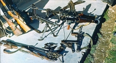 Manufacture d'armes, actuellement Musée de l'automobile - English: Soviet war in Afghanistan. Mujahideen weaponry seized in the Badakhshan province by the KGB special detachment: grenade launchers, machine-guns, submachine-guns, rifles, sawed-offs, shotguns, handguns, etc.
