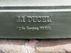 Onze fontaines - Français:   Raon-l\'Etape (Vosges): Fontaine de Minerve, située rue Aristide-Briand. C\'est l\'une des 11 fontaines de Raon-l\'Etape exécutées entre 1860 et 1864 sur des modèles de Jean-Jacques Ducel, et classées MH. - marque de fondeur JJ DUCEL / [m? maître?] de Forges,, Paris