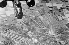 Gare - English:   Daylight bombing raid on the railway yards at Tourcoing, France by a Douglas Boston aircraft of 2nd Tactical Air Force. Photograph taken by an RAF cameraman flying in one of the attacking Boston aircraft.