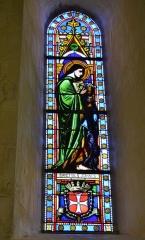 Eglise - English: L'église. Vitrail de Saint-Jean-l'Évangéliste.