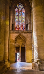 Eglise Notre-Dame -  My daughter stood in the door of St. Lo cathedral. It wasn't much more than a snap, but I like the way the light from the stained-glass window and the door work here.