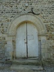 Eglise Saint-Pierre - Français:   Le portail roman de l\'église de Boulon aux archivoltes décorées d\'étoiles creuses et reposant sur des tailloirs à palmettes .