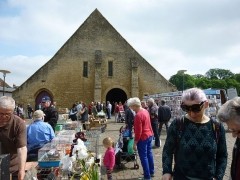 Halles - English:   A busy weekly market outside the 11th century market hall in St Pierre sur Dives, Normandy, France.