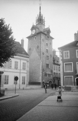 Beffroi - Street view in Beaune. Girl with a doll\'s pram.  Gatuvy i Beaune. Flicka med dockvagn.  Location: Beaune, Côte-d\'Or, Bourgogne, France  Photograph by: Berit Wallenberg  Date: 27.06.1937 Format: Film  Persistent URL: kmb.raa.se/cocoon/bild/show-image.html?id=16001000186964  Read more about the photo database (in english): www.kms.raa.se/cocoon/bild/about.html