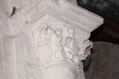 Eglise Saint-Pierre - English:  Judgment (?): A man hold a naked woman while the central character, impassible has a writing on his knees, on the other side, two men quarrel with each other ...