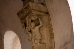 Eglise Saint-Pierre - English:  A man lifts a stone to crush a snake.