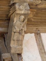 Maison à pans de bois - Français:   Il s\'agit de la sculpture de Saint-Vincent sur la maison de l\'arbre de Jessé aujourd\'hui le musée de la ville. Il faut également remarquer les scultures de têtes de loups au dessus.