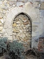 Eglise et cimetière qui l'entoure - Français:   Porte murée au sud de la nef.