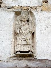 Anciens bâtiments de la Grange aux dîmes -  Statue de saint Denis céphalophore.