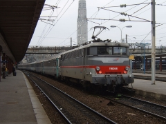 Ensemble architectural -  BB116058 at Amiens on 18 March 2006. The loco has just replaced a BB67400 on train 2022, 10:46 Boulogne-Ville to Paris Nord.  Workings like these have been the norm for many years on the classic route to Paris. Originally trains started back at Calais Maritime with much longer Corail sets and often double headed with 2 BB67400s. After the withdrawal of rail-sea services via Calais, the Maritime station in Calais was closed and these services started and finished at Calais-Ville. Some years later Paris trains were cut back to start at Boulogne.