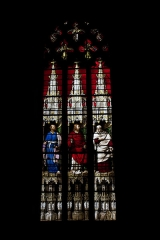 Eglise Notre-Dame - English:  Stained glass of the chapel of St. Andrew: Christ flanked by St. Peter (on left) and St. Paul (on right).
