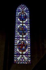 Eglise Notre-Dame - English:  Stained glass of the chapel of St. Aubin, from top to bottom are represented the crucifixions: of Christ, of St. Peter and St. Andrew.