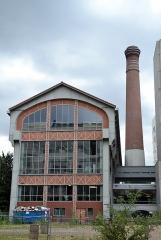 Usine de la Société Urbaine d'Air Comprimé (SUDAC) -  Ancienne usine d'air comprimé de la rue Jean-Antoine de-Baïf près du quai Panhard-et-Levassor dans le 13e arrondissement de Paris, aujourd'hui intégrée à l'école nationale supérieure d'architecture de Paris-Val de Seine.