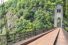 Viaduc des Rochers Noirs (également sur commune de Soursac) - Viaduc des Rochers Noirs,  (Classé, 2000) Inauguré en 1913 par le président Raymond Poincaré, il fut emprunté jusqu'en 1959 par le