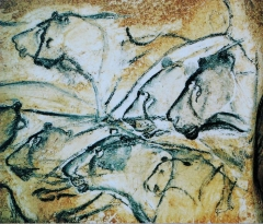 """Grotte ornée du paléolithique supérieur située au lieudit """"Combe d'Arc"""" dite grotte Chauvet - English: Lions painted in the Chauvet Cave. This is a replica of the painting from the Brno museum Anthropos. The absence of the mane sometimes leads to these paintings being described as portraits of lionesses."""