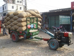 Château de Bourgon - English: Chinese Sifeng Model 12 horsepower two-wheel tractor and trailer with 70 bags of rice each weighing 80 kilograms, waiting in line to enter an Ishurdi, Bangladesh rice mill.