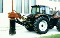 Château de Bourgon - English: A rotor stump remover with tractor and root cutting ring.