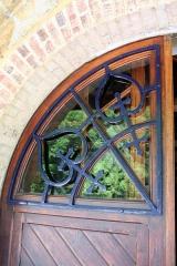 Maison de Monte au Lever - Français:   Détail de la porte principale de Monte au Lever.