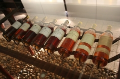 Château d'Yquem -  An assortment of the white French dessert wine from Bordeaux with the color change of the various vintages as they age.