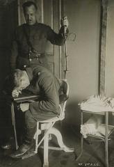"""Maison du Peuple - Issoudun, France. Siège tournant inventé par Robert Bárány comme test médical (ici appliqué à une personne voulant devenir pilote d'avion de guerre)  (R. Bárány était un médecin autrichien né le 22 avril 1876 à Vienne et mort le 8 avril 1936 à Uppsala en Suède)  Voiur aussi: Bárány chair Otis Historical Archives  of """"National Museum of Health & Medicine""""  (OTIS Archive 1)"""