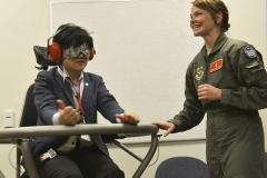 Maison du Peuple - English: Staff Sgt. Bethany Whiteley, 92nd Aerospace Medical Squadron aerospace physiology craftsman demonstrates the Barany chair with a Japanese instructor from Iwate Prefectural University in Morioka, Japan during a base tour March 3, 2015, at Fairchild Air Force Base, Wash. The Barany chair is a training tool that helps Airmen understand spatial disorientation and learn to trust the instruments. (U.S. Air Force photo/Senior Airman Janelle Patiño)