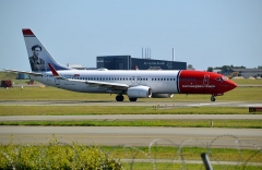 Château de la Sauge -  Boeing 737/8 of Norwegian Air Shuttle,with tail depicting