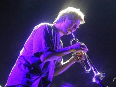 Eglise Saint-Laurent -  Nils Petter Molvær, playing his trumpet at Global Tempera 2001, in the old Fokus Kino cinema building in Tromsø, Norway. Photo: Krister Brandser
