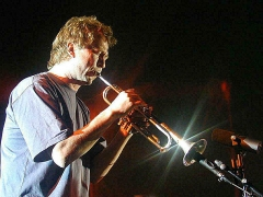 Eglise Saint-Laurent -  Nils Petter Molvær, playing his trumpet at Global Tempera 2001, in the old Fokus Kino cinema building in Tromsø, Norway. Photo: Krister Brandser