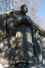 Monument Jacquard - English:  Ribbon worker woman.