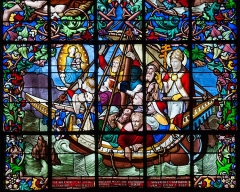 Eglise Notre-Dame du Voeu, à Octeville - English: Lower section of the stained glass window in the north transept, created 1857 by the stained glass workshop of Adolphe Napoléon Didron. The artwork is titled Espérance (hope) and depicts the voyage of Matilda in 1145 from England to Normandy where, according to the legend of Chantereyne, Matilda, in the midst of a tempest that threatened the ship, promised to the Virgin Mary to build a chapel on the spot where she sets foot again on land. Not just a chapel was built but also Abbaye Notre-Dame du Vœu in Cherbourg was founded. (See Martine Callias Bey and Véronique David, Les vitraux de Basse-Normandie, ISBN 2-7535-0337-0, p. 61.)