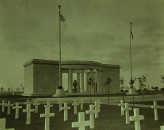 Cimetière américain -  Lot 6591-4:  St. Mihiel American Cemetery, France, located about 20 miles northwest of Verdun, and is the burial place of over 4,000 American soldiers, most of whom lost their lives in the operations of the American First Army beginning September 12th and ending September 16, 1918.  This operation, in which 15 American divisions (employing a total of about 550,000 men) and 4 French divisions, took part, freed the Paris-Nancy railroad and resulted in the reduction of the St. Mihiel salient.  Shown: Front View-Chapel-Thiaucourt Cemetery.  President Franklin D. Roosevelt Collection-Photograph Album presented by General John J. Pershing, USA (Ret.), Chairman, American Battle Monuments Commission.   The photographs in the collection were taken in 1923 to show the memorials erected by the American Battle Monuments Commission.  Photographed through Mylar sleeve. (2015/10/09).