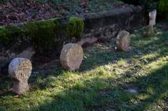 Eglise Saint-Sébastien -  Broken  headstones of the Parish close of the St. Sebastian church at  Jatxou.