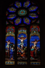 Eglise Saint-Jean-Baptiste -  Crucifixion, stained glass from the workshops of Charles-François Champigneulle, master glassmaker in Bar-le-Duc (1882)