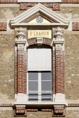 Collège Sainte-Barbe - English: Window of the interior court of the Collège Sainte-Barbe, Paris, bearing the name of V. Charon.