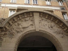 Palais de la Femme -  Palais de la Femme, an hotel for women of the Salvation Army. General view. Address: 84 rue de Charonne; Paris 11. France. Bas-relief on the main entrance porch.