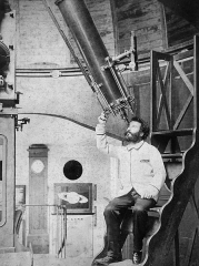 Observatoire Camille Flammarion - English:   Camille Flammarion at the eyepiece of his 9½-inch Bardou refractor at his Juvisy observatory mid-1880s