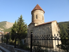 """Ancienne distillerie-usine de mise en bouteille dite """"usine Clacquesin"""" -  A last look at the Church of Kish before we move on. This is the oldest church in the Caucasus originally used by the Albanians. The church is no longer in active use and is preserved now as a museum. Despite the beautiful surroundings, getting here was a real torture on a single track super steep flag-stone road on the face of the mountain. Out Hyundai Accent car refused to climb on a couple of occasions but we eventually made it. Although the way down is different, our already difficult ascent was made even worse by traffic coming down the mountain- the wrong way- leading to several back and forth switchbacks. Detailed notes about the Church of Kish appeared in previous captions earlier in this album. (Sheki, Azerbaijan, Sept. 2017)"""