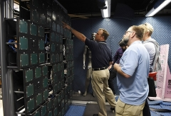Chapelle Saint-Berchaire -  Office of Naval Research (ONR) Global science advisors JD Morrison, left, and Roger Kuhn, get an up-close look at a possible new type of full-body scanner technology or metaimager, located at Duke University, during their spring industry tour to North Carolina's Research Triangle. Science advisors are assigned to the staffs of combatant commands, as well as major Navy and Marine Corps commands worldwide, and focus on delivering science and technology solutions to solve operational problems. (U.S. Navy photo by John F. Williams/Released)