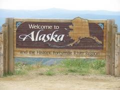 "Eglise paroissiale Saint-Martin -  ""Welcome to Alaska"", Alaska boder at Poker Creek on the Top of the World Highway, Alaska, Yukon Border. Photographed on 13 August 2009.  Joint ©© Arthur D. Chapman and Audrey Bendus."