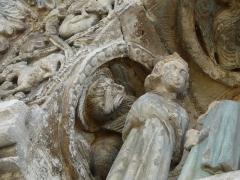 Eglise Saint-Pierre-et-Saint-Paul - Le lion de saint Marc, détail des sculptures au-dessus du portail nord de l'église Saint-Pierre et Saint-Paul de Grand-Brassac, Dordogne, France.