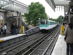 Métropolitain, station Barbès-Rochechouart -  Train aproaching platform of the Barbes-Rochechouart station of metro in Paris (Line2)