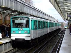 Métropolitain, station Barbès-Rochechouart -  Photograph of subway train in Paris.