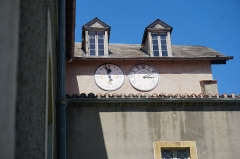 Chapelle Notre-Dame-de-Garaison et bâtiments conventuels - English: The clocks within the inner courtyard of The Notre-Dame-de-Garaison. One appears to be a moon phase clock and the other a normal clock. Photo taken on 23 August 2019.