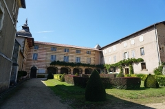 Chapelle Notre-Dame-de-Garaison et bâtiments conventuels - English: The open courtyard at the entrance of the Notre-Dame-de-Garaison. The front aspect of the photo shows the gardens and the rear shows the walkway leading to the section of the building currently used as the middle school. To the right is the entrance to the building, and to the left is the entrance to the chapel. Photo taken on 23 August 2019.