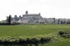 Eglise Saint-Vincent -  Montréal de l'Aude, sighted from the road Bram. The collegiate St. Vincent dominates the village and stands for miles around.