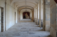 Ancien prieuré dit  château  de Cassan - English:   Ground floor hall of the Château-Abbey de Cassan looking southwards. The hall runs along the eastern side of the main building providing access to the chapel at its southern end and to the kitchens at its northern end. The principal rooms are on the western side of the hall while the eastern side is glazed providing a view over the courtyard.
