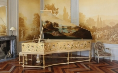 Ancien prieuré dit  château  de Cassan - English:   Painted piano in the music salon, Cassan Abbey, France. The salon was dedicated to Madame de Brimont, mistress of the Prince of Conti, lord of Pézenas who bought the chateau in 1791. Legend has it that Madame de Brimont\'s ghost plays the paino at night-time. This illusion is perpetuated by  a modern electronic piano that has been painted to look like an 18th century piano that will play music under the direction of an invisible ghost. In reality, a microphone picks up the request and the music is played by an operator in another room.